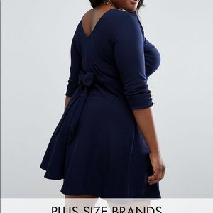 Navy Blue Skater Dress with bow in the back.